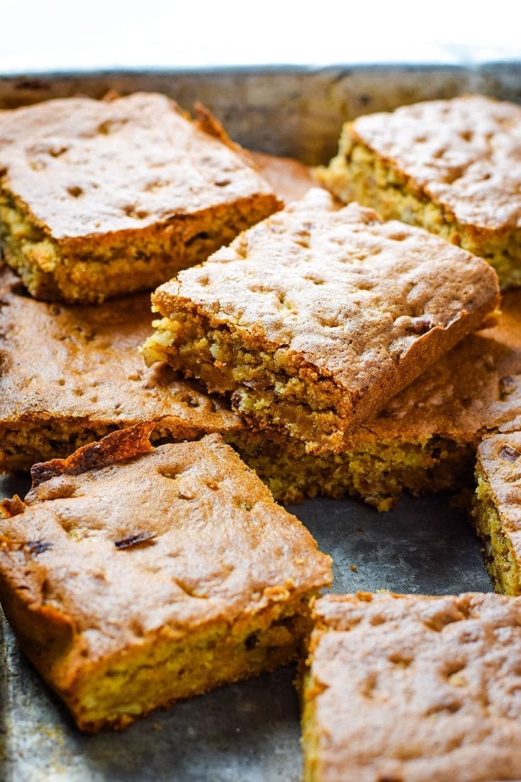 a tray of sliced pecan chewy cake bars aka pecan chewies