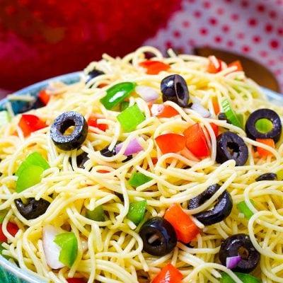 Spaghetti Pasta Salad with fresh veggies in a blue bowl