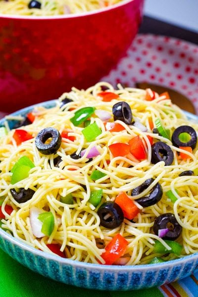 Spaghetti Pasta Salad with fresh veggies in a blue bowl