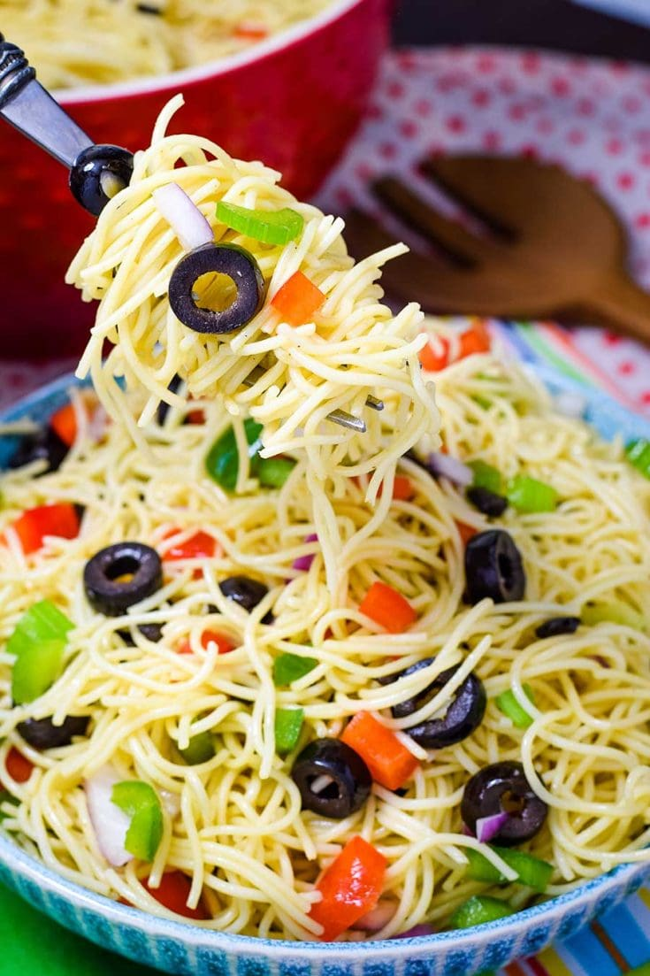 Fork Full of Spaghetti Pasta Salad with Fresh Veggies in a BLue Bowl