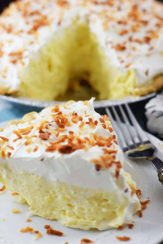 Coconut Cream Pie Slice on plate with cfork