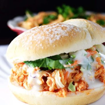 A closeup of this slow cooker buffalo chicken served as a sandwich