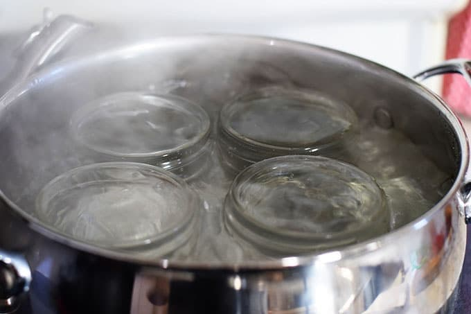 Mason Jars Boiling in Pot of Water to Sterilize