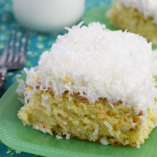 Coconut Cream Poke Cake on a green plate