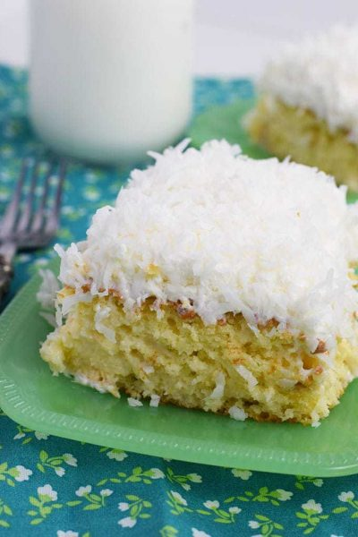 Coconut Cream Poke Cake on a green plate
