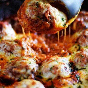 Cheesy Meatballs and Marinara in a cast iron skillet.