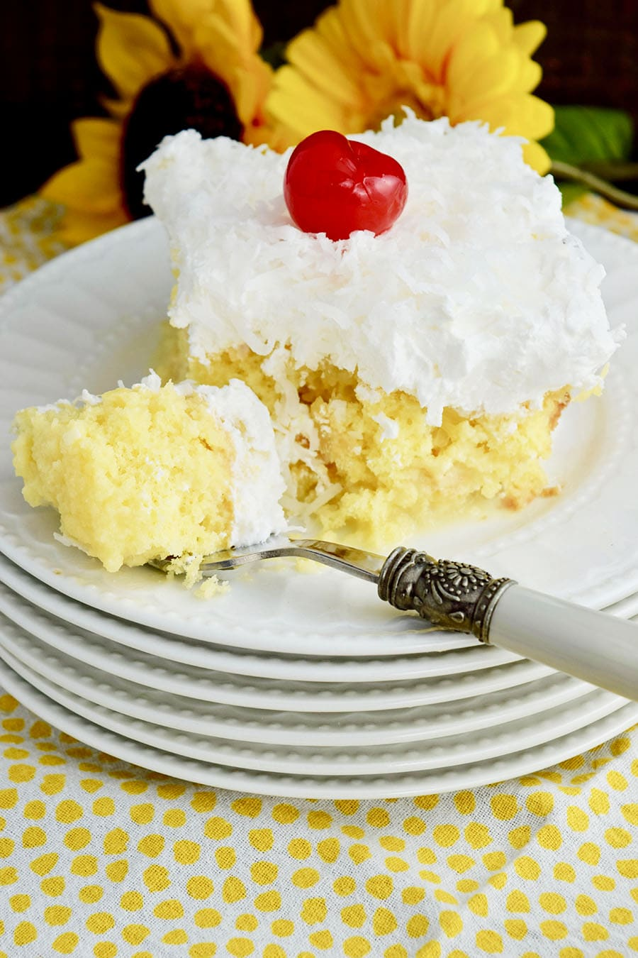 Pina Colada Poke Cake with Fork
