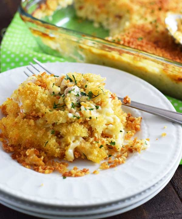 Easy Chicken and Rice Casserole on a white plate with fork