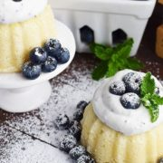 Mini Almond Bundt Cakes with Blueberry Whipped Cream Garnished with blueberries