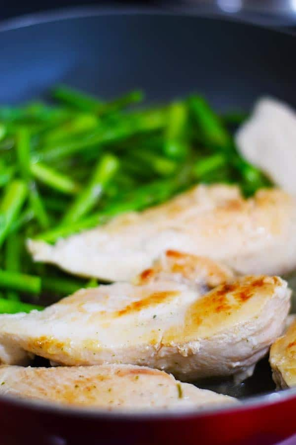 Chicken and Asparagus cooking in a skillet
