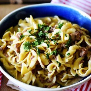 Instant Pot Creamy French Onion Ground Beef and Noodles in a blue bowl