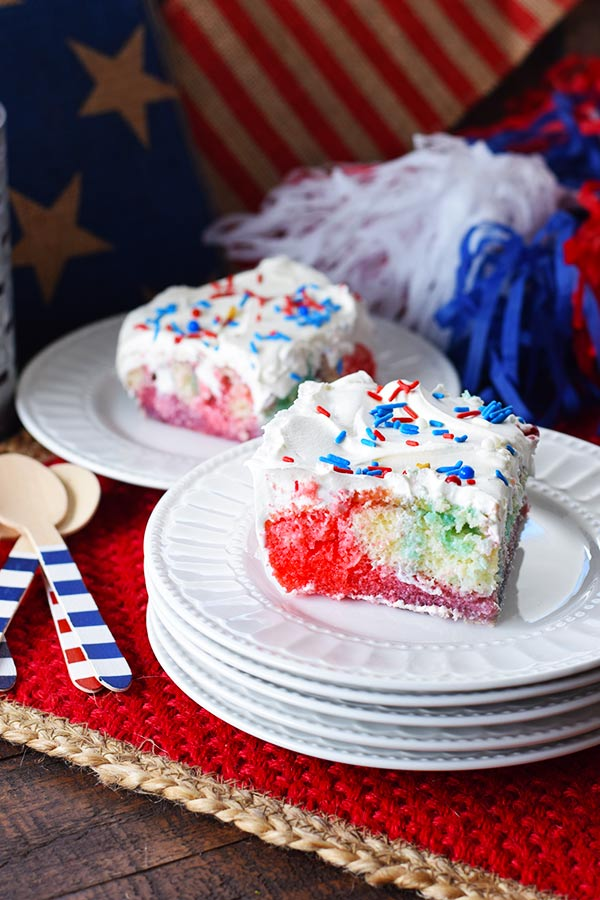 Slice of Red White and Blue Poke Cake
