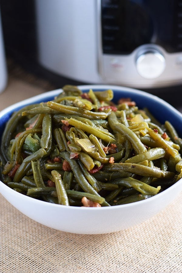 Instant Pot Southern Style Green Beans and Bacon in a white and blue bowl