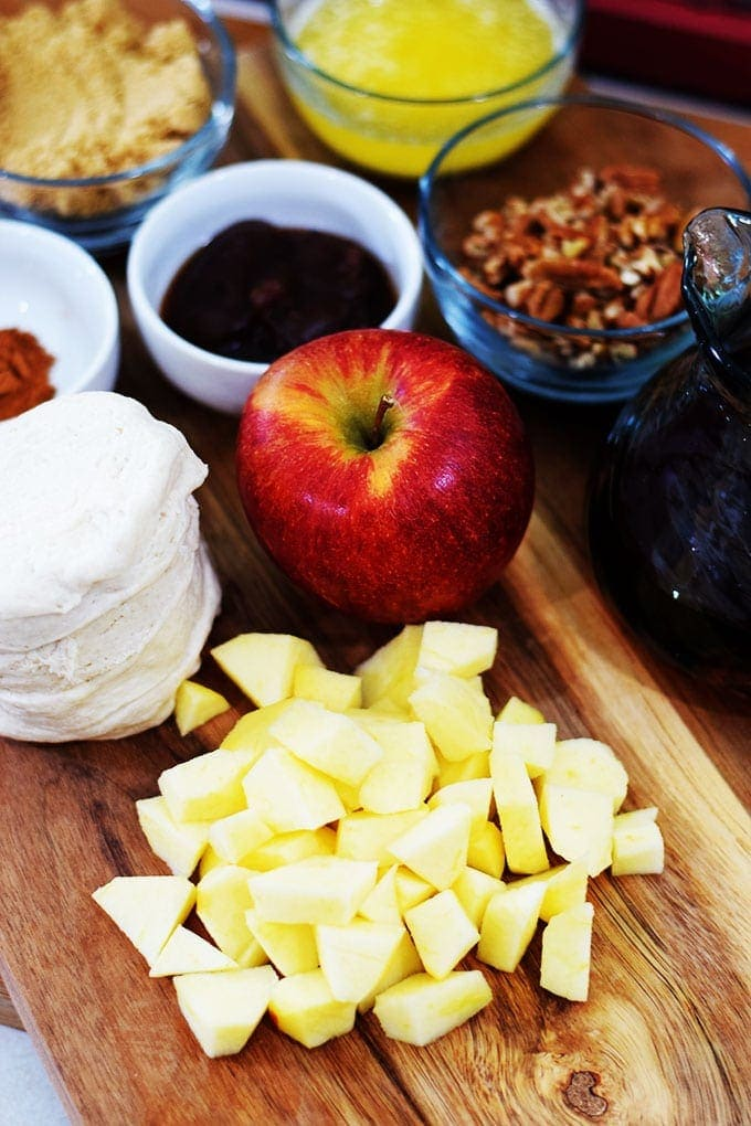 the ingredients for this apple pecan sticky bun bites like biscuit dough, diced apple, pecans, and sugar