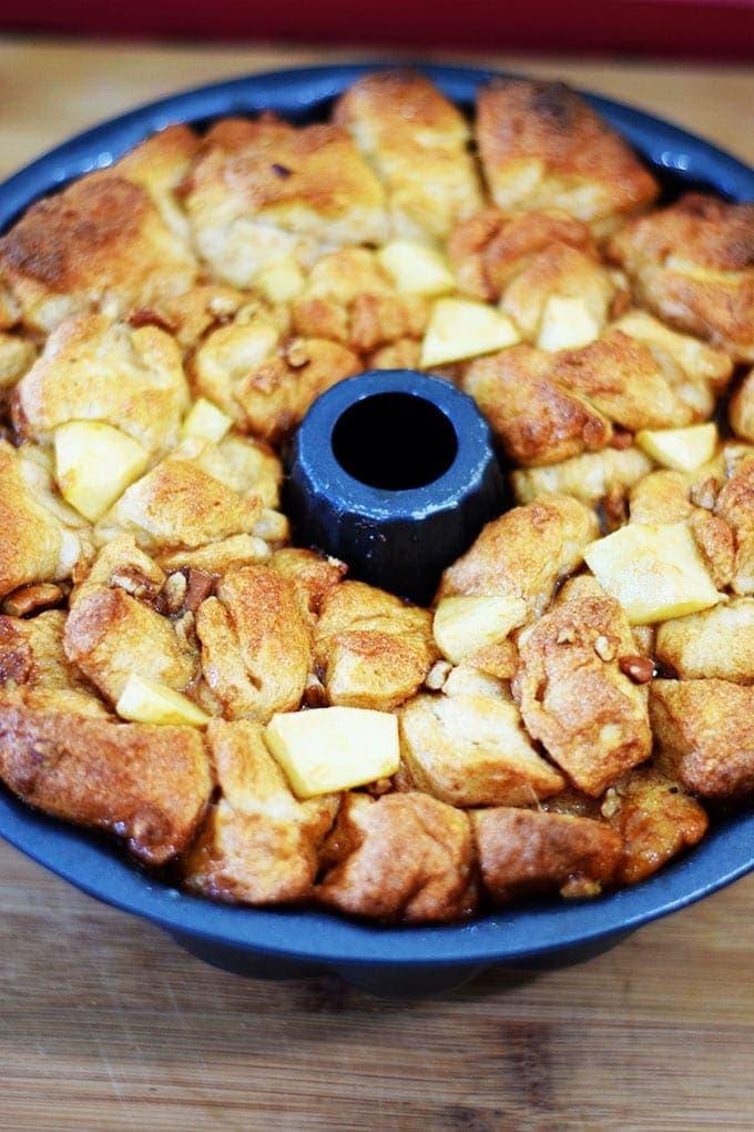 An overhead shot of the baked apple pecan sticky bun bites in a bundt pan