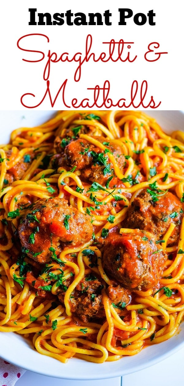 A close up of this Instant Pot spaghetti and meatballs with noodles, marinara sauce, and chopped basil