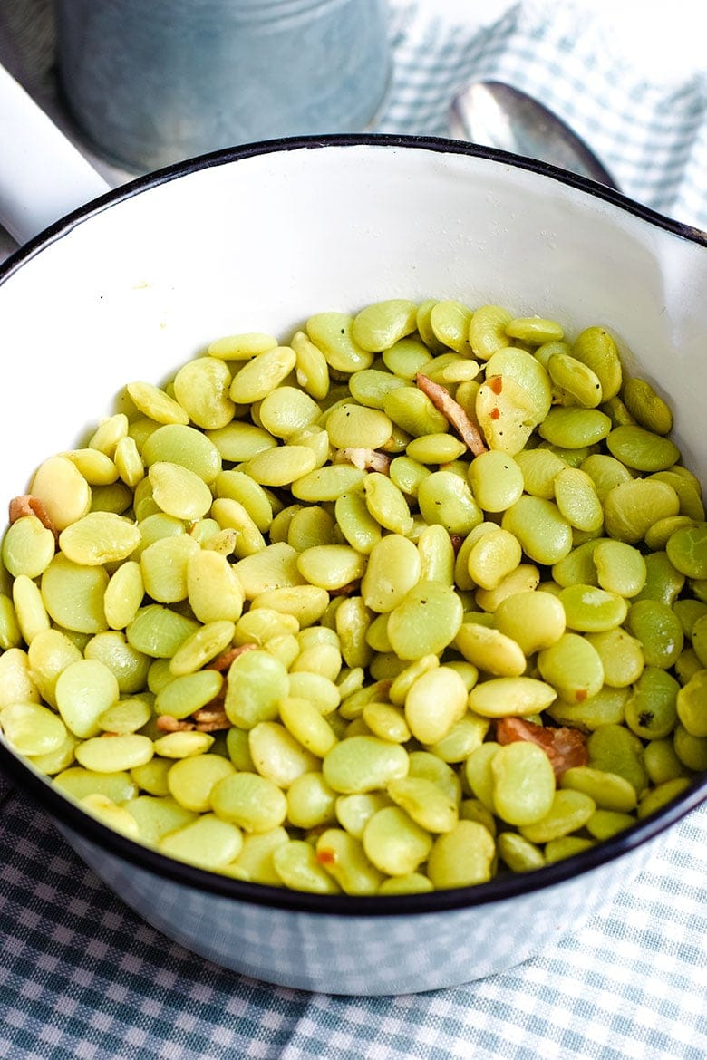 A ceramic cooking pot filled with these southern-style baby lime beans