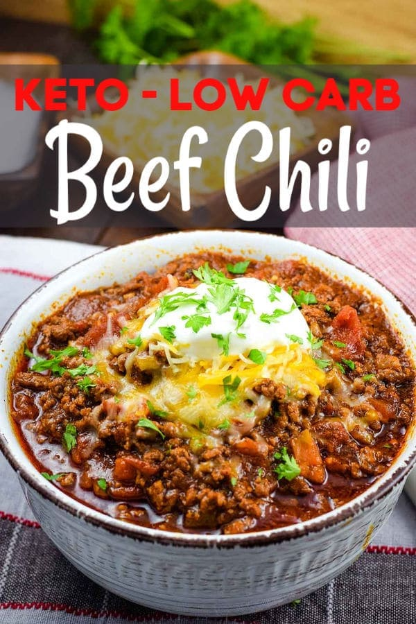 The Pinterest image of a bowl of this low-carb no-bean chili recipe topped with shredded cheese, sour cream, and parsley
