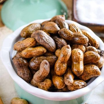 Boiled peanuts in a green bowl.