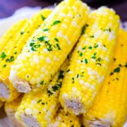 A plate of Instant Pot Corn on the Cob with chopped, fresh parsley