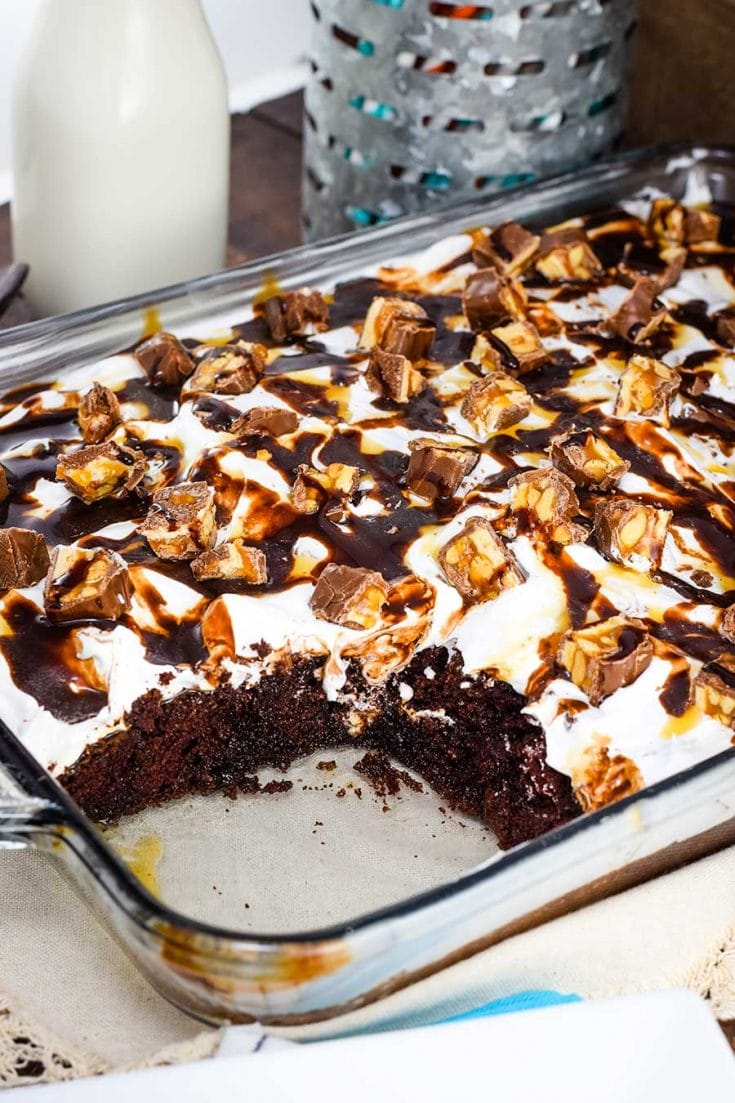 Decadent Snickers Poke Cake in a 9 X 13 baking dish
