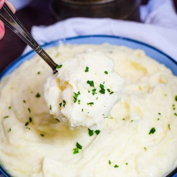 Slow Cooker Mashed Potatoes in a Blue Bowl