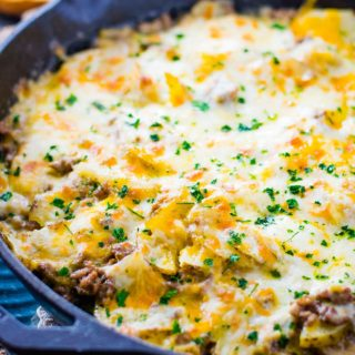 An overhead shot of this Easy Ground Beef and Potatoes Skillet garnished with fresh parsley