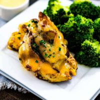 Alice Springs Chicken (Outback Copycat) served on a white plate with steamed broccoli