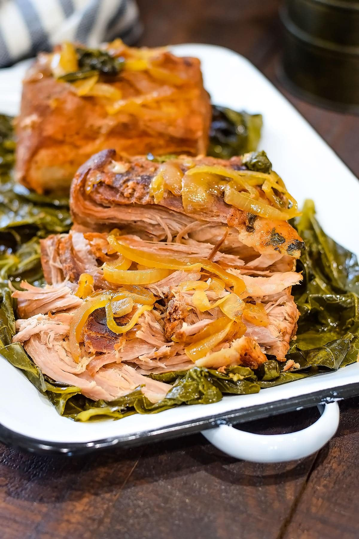 Pulled collard greens wrapped pork loin roast