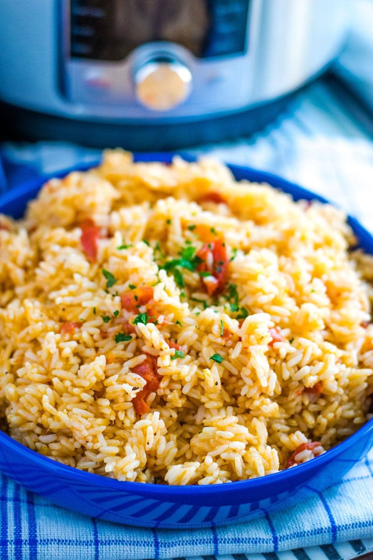 Instant Pot Tomatoes and Rice in a blue serving dish