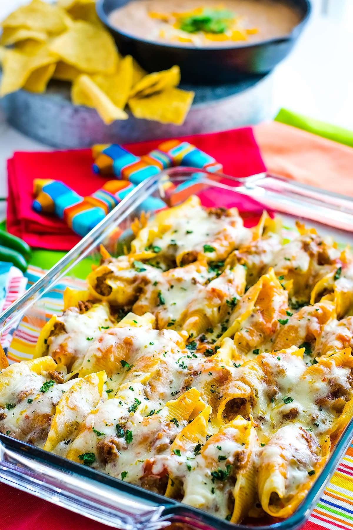 Mexican stuffed shells topped with melted pepperjack cheese in a casserole dish