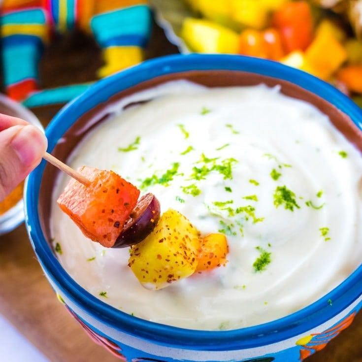 Fruit kabob dipped into a sweetened lime yogurt dip.