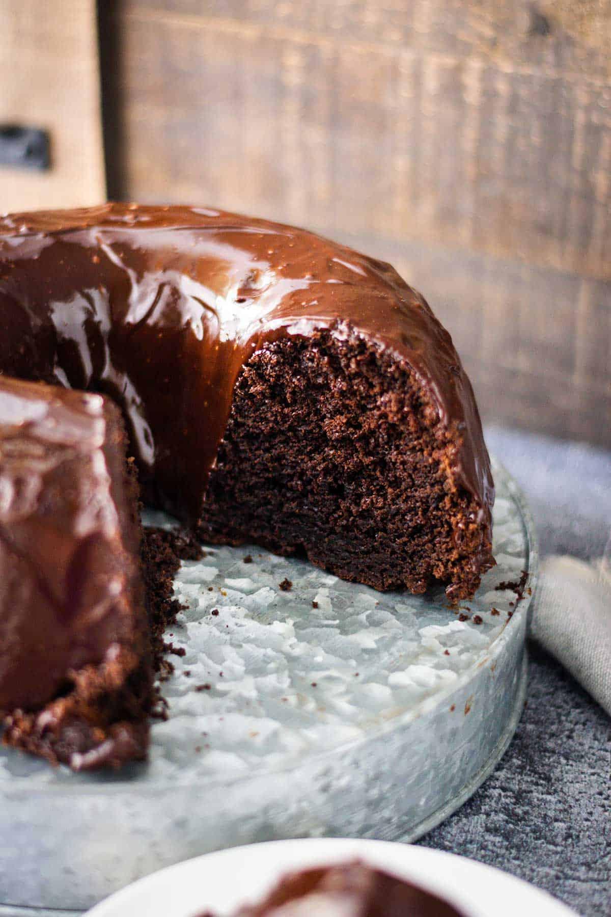 Chocolate Brownie Bundt cake on a galvanized cake server.