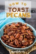 Pinterest image showing toasted pecans in a blue bowl.