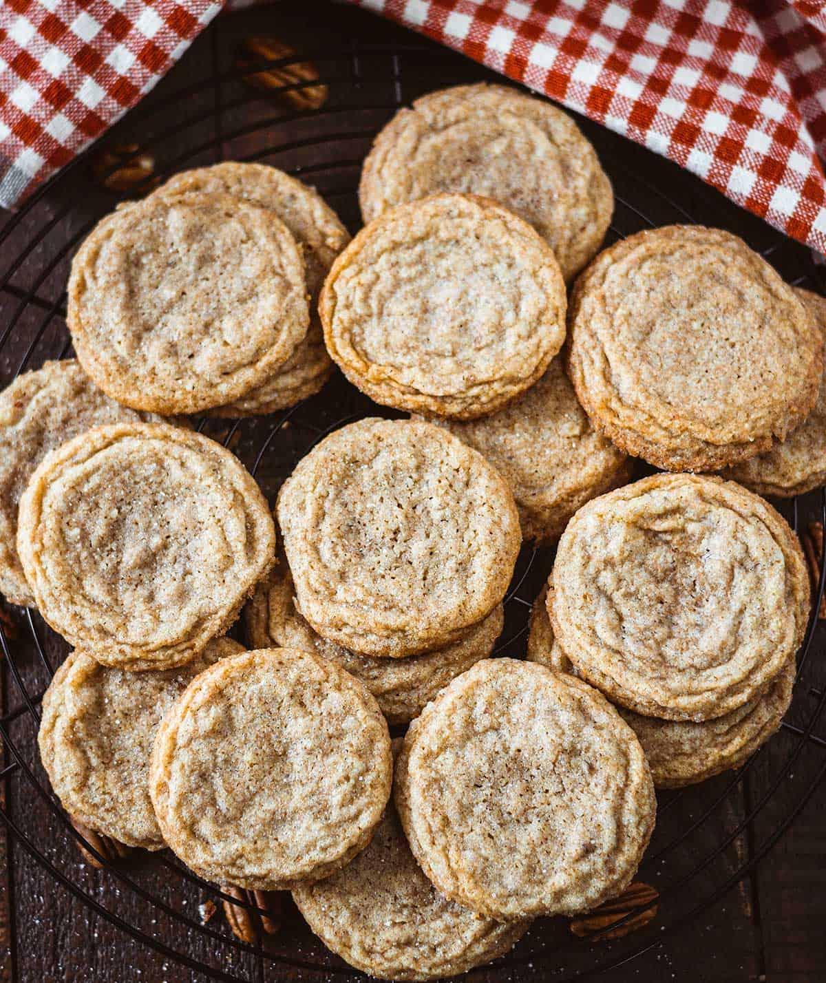 Overhead shot of pecan butter cookies on a wire baking rack.